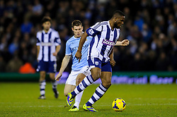 West Brom Forward Victor Anichebe is challenged by Man City Midfielder James Milner (ENG) during the second half of the match - Photo mandatory by-line: Rogan Thomson/JMP - Tel: Mobile: 07966 386802 - 04/12/2013 - SPORT - FOOTBALL - The Hawthorns Stadium - West Bromwich Albion v Manchester City - Barclays Premier League.