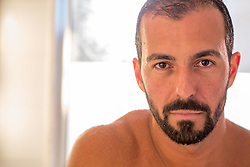 portrait of a handsome Latin man with a goatee