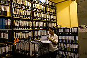 Guarani teacher Maria Antonia Andrada browses for documents on an archive of students and works, all written and classified in Guarani in Asuncion, Paraguay, Thursday, Dec. 14, 2017. Paraguay today is trying to promote a positive image of Guaraní language but bilingual education programme is under resourced and has failed to reach many areas of rural or impoverished parts of Paraguay, where Guaraní speakers are still schooled through Spanish, leading many to drop out. Part of the issue is that the language taught in schools is not that of the streets, with teachers tending to be puritanical and teaching words that have long since fallen out of use. (Dado Galdieri for The New York Times)