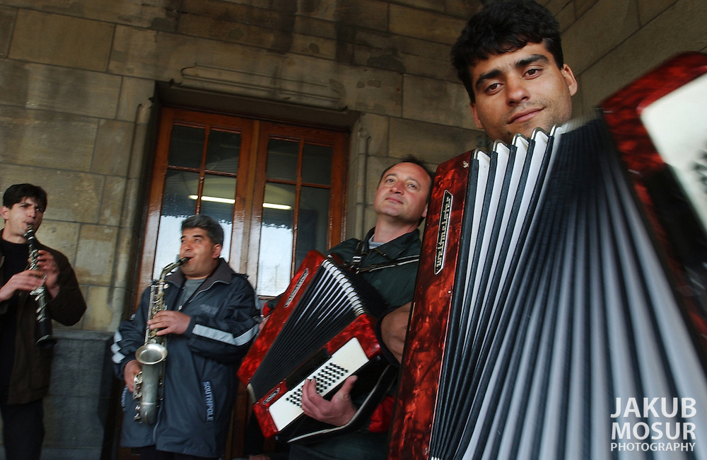 Roma street musicians perform for Euros in front of the central train station in Amsterdam on March 27, 2002. Photo by Jakub Mosur