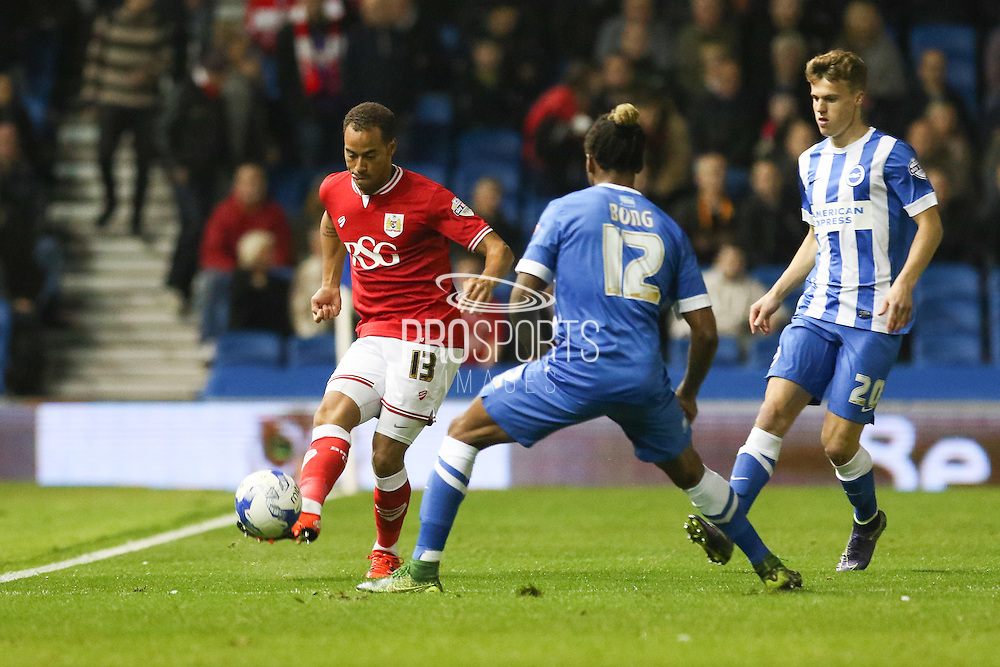 Bristol City midfielder Elliott Bennett (13) passes the ball forward during the Sky Bet Championship match between Brighton and Hove Albion and Bristol City at the American Express Community Stadium, Brighton and Hove, England on 20 October 2015. Photo by Phil Duncan.