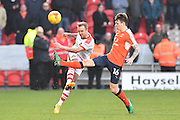 James Coppinger (26) Doncaster Rovers midfielder and Glen Rea (16) Luton Town FC defender during the EFL Sky Bet League 2 match between Doncaster Rovers and Luton Town at the Keepmoat Stadium, Doncaster, England on 18 February 2017. Photo by Ian Lyall.