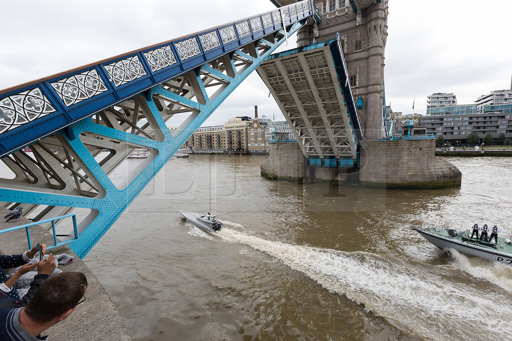 © Licensed to London News Pictures. 05/09/2016. LONDON, UK.  Bladerunner passing under Tower Bridge with HMS Anchor on the River Thames. The Royal Navy test out Bladerunner, their new prototype high speed drone speedboat on the River Thames in London this afternoon ahead of a major exercise. It is part of the Royal Navy's Unmanned Arrior program, which seeks to find an edge in the field of naval combat.  Photo credit: Vickie Flores/LNP