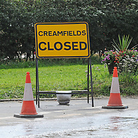 DARESBURY, UK:.Roadsigns warning that Creamfields festival had been closed early by extreme weather  on Sunday, 26th August 2012..PHOTOGRAPH BY TERRY KANE / BARCROFT MEDIA LTD..UK Office, London..T: +44 845 370 2233.E: pictures@barcroftmedia.com.W: www.barcroftmedia.com..Australasian & Pacific Rim Office, Melbourne..E: info@barcroftpacific.com.T: +613 9510 3188 or +613 9510 0688.W: www.barcroftpacific.com..Indian Office, Delhi..T: +91 997 1133 889.W: www.barcroftindia.com