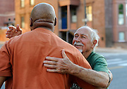 Danny Thomas hugs from Anthony Cymerys, known as Joe the barber, after his haircut in Hartford, Conn., Wednesday, May 1, 2013.