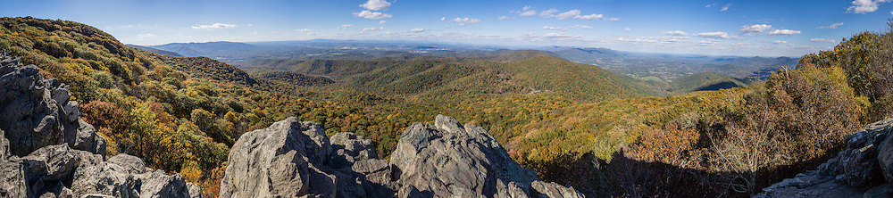 Hike to expansive views of the Shenandoah Valley (left) and Rockfish Valley (right) on the popular Humpback Rocks Trail (2 miles round trip with 700 feet gain) from Milepost 6 on the Blue Ridge Parkway of Virginia, in the Blue Ridge Mountains (a subset of the Appalachian Mountains), USA. Optionally connect to longer loops of 3 to 7 miles, or to the 2182-mile Appalachian Trail. At adjacent Parkway Milepost 5.8, explore the restored 1890s Humpback Rocks Mountain Farm. The scenic 469-mile Blue Ridge Parkway was built 1935-1987 to aesthetically connect Shenandoah National Park (in Virginia) with Great Smoky Mountains National Park in North Carolina, following crestlines and the Appalachian Trail. This panorama was stitched from 17 overlapping photos.
