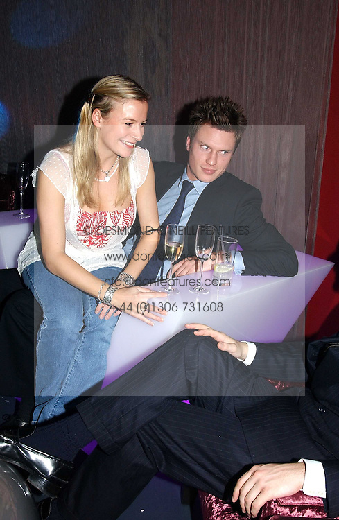 LADY ROSE WINDSOR and GEORGE GILMAN at a party hosted by Panerai and the Baglioni Hotel, 60 Hyde Park Gate, London on 6th December 2004.<br />