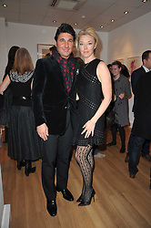 GIORGIA VERONI and his wife TAMARA BECKWITH at a party to launch Alistair Taylor-Young's new book 'The Phone Book' held at The Little Black Gallery, 13A Park Walk, London SW10 on 18th January 2011.