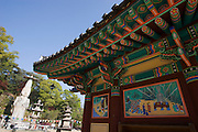 Gwanchoksa temple. The Eunjinmireuk, 19 meters high, wearing a strange crown and more than 1000 years old, is possibly South Korea's most extraordinary statue af Buddha. Here its story is told in a painting on a temple wall.