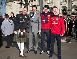 CARDIFF, WALES - Thursday, March 1, 2012: Members of the Football Association of Wales take part in the 10th St. David's Day Parade through the streets of Cardiff. Wales manager Chris Coleman, his son and head of pubic affairs Ian Gwyn Hughes with his son. (Pic by David Rawcliffe/Propaganda)