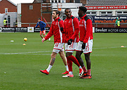 Wes Burns of Fleetwood Town, Amari'i Bell of Fleetwood Town  and Jordy Hiwula of Fleetwood Town warming up during the EFL Sky Bet League 1 match between Fleetwood Town and Blackpool at the Highbury Stadium, Fleetwood, England on 25 November 2017. Photo by Paul Thompson.
