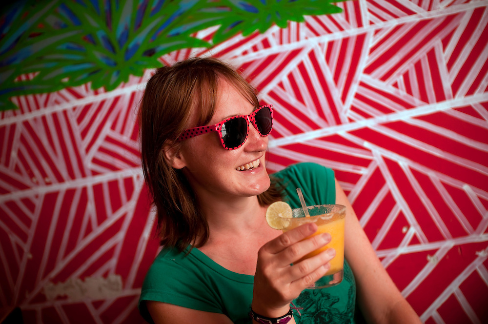 Tamlyn Clake, 26, a tourist from Brisbane, Australia, enjoys a mango margarita at Agave Azul Mexican restaurant in Santa Marta, Colombia. (Calle 14, No 3-58)