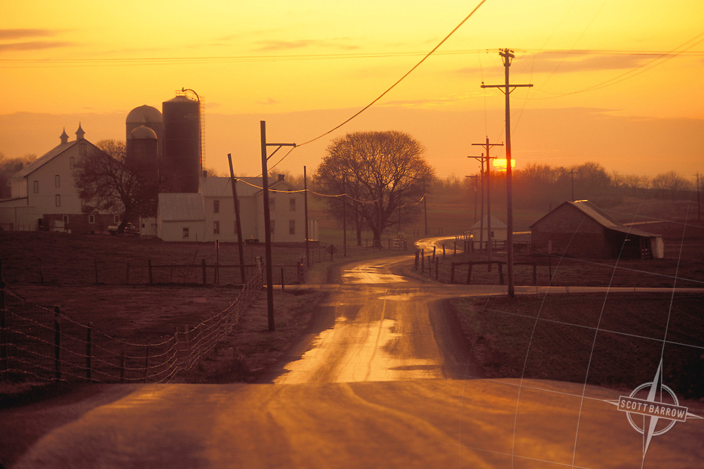 Country farm road at sunset