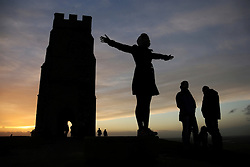 © Licensed to London News Pictures. 21/12/2013. Glastonbury, UK Sunset at Glastonbury Tor on the shortest day of the year - today, 21 December is the Winter Solstice. Photo credit : Jason Bryant/LNP