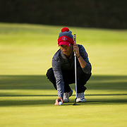 26 March 2018: Haleigh Krause repositions her ball on the fifth green during the opening round of the March Mayhem Tournament hosted by SDSU at the Farms Golf Club in Rancho Santa Fe, California. <br /> More game action at sdsuaztecphotos.com
