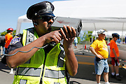 A Rochester Police Officer clocks competitors on his radar gun at a local soapbox derby race on Lakeshore Boulevard in Irondequoit on Saturday, May 31, 2014. Eighty-two competitors raced in six divisions, with the winner of each division advancing to the world championships in Akron, Ohio.