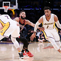 26 March 2016: Los Angeles Lakers guard D'Angelo Russell (1) drives past Portland Trail Blazers guard Allen Crabbe (23) on a screen set by Los Angeles Lakers forward Larry Nance Jr. (7) during the Portland Trail Blazers 97-81 victory over the Los Angeles Lakers, at the Staples Center, Los Angeles, California, USA.