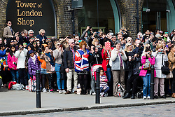 © Licensed to London News Pictures. 21/04/2016. London, UK. Crowds of people watch the Honourable Artillery Company (HAC) fire a 62 round gun salute at The Tower of London, near Tower Bridge to mark the 90th birthday of Great Britain's Queen Elizabeth II. A Royal Salute normally comprises 21 guns, but is increased to 41 if fired from a Royal Park or Residence and uniquely, at The Tower of London, a total of 62 rounds are fired on Royal anniversaries, including an additional 21 guns for the citizens of the City of London to show loyalty to the Monarch.  Photo credit : Vickie Flores/LNP