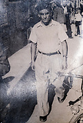 ca 1930s man walking in the street photo with light reflection