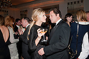 LAURA BAILEY; ARPAD BUSSON, Harper's Bazaar Women Of the Year Awards 2011. Claridges. Brook St. London. 8 November 2011. <br /> <br />  , -DO NOT ARCHIVE-© Copyright Photograph by Dafydd Jones. 248 Clapham Rd. London SW9 0PZ. Tel 0207 820 0771. www.dafjones.com.