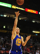 Feb. 10, 2011; Phoenix, AZ, USA; Golden State Warriors guard Stephen Curry (30) puts up a shot against the Phoenix Suns at the US Airways Center. Mandatory Credit: Jennifer Stewart-US PRESSWIRE
