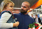 Warsaw, Poland - 2017 October 03: Mikolaj Burda Polish rower smiles to his daughter while welcome of Polish Rowing National Team at Chopin Airport on October 03, 2017 in Warsaw, Poland.<br /> <br /> Mandatory credit:<br /> Photo by &copy; Adam Nurkiewicz / Mediasport<br /> <br /> Adam Nurkiewicz declares that he has no rights to the image of people at the photographs of his authorship.<br /> <br /> Picture also available in RAW (NEF) or TIFF format on special request.<br /> <br /> Any editorial, commercial or promotional use requires written permission from the author of image.