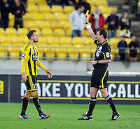 Referee Peter Green yellow cards the Wellington Phoenox's Jeremy Brockie against Sydney FC in the A-League foootball match at Westpac Stadium, Wellington, New Zealand, Saturday, October 06, 2012. Credit:SNPA / Ross Setford