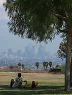 With the downtown Los Angeles skyline visible through the heat and haze, people rest in the shade on the lawn at Kenneth Hahn State Recreation Area on Wednesday, August 30, 2017, in Los Angeles.  ``The combination of strong high pressure and weak onshore flow will continue to produce dangerously hot temperatures across the region through at least the end of the week and possibly into the labor day weekend,'' according to a National Weather Service statement, which predicted more heat records a day after a few were set.(Photo by Ringo Chiu)<br /> <br /> Usage Notes: This content is intended for editorial use only. For other uses, additional clearances may be required.