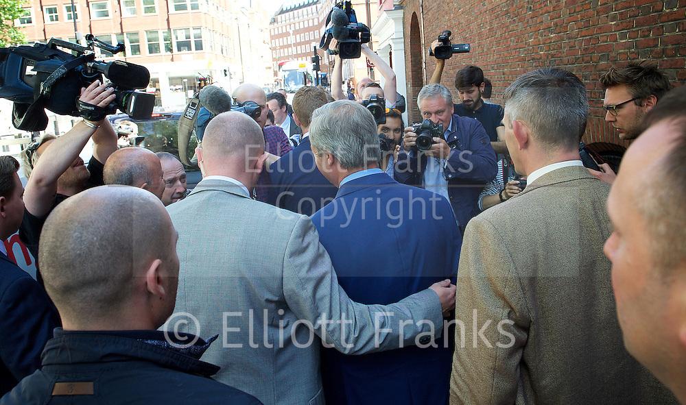 Nigel Farage <br /> UKIP Leader <br /> Resignation speech <br /> at Emmanuel Centre, Westminster, London, Great Britain <br /> 4th July 2016 <br /> <br /> <br /> Nigel Farage surrounded by media on his way back to his car <br /> <br /> <br /> Photograph by Elliott Franks <br /> Image licensed to Elliott Franks Photography Services