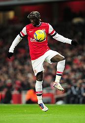 Arsenal's Bacary Sagna controls the ball - Photo mandatory by-line: Dougie Allward/JMP - Tel: Mobile: 07966 386802 16/01/2013 - SPORT - FOOTBALL - Emirates Stadium - London  -  Arsenal V Swansea City - FA Cup Third-Round replay