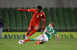 Oman's Raed Ibrahim Saleh in action against Ireland's  Stephen Quinn - Mandatory by-line: Ken Sutton/JMP - 31/08/2016 - FOOTBALL - Aviva Stadium - Dublin,  - Republic of Ireland v Oman -