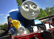 A young boy climbs down from Thomas the Tank Engine, while waiting to take a ride on the train at the Buckingham Valley Train Station, Friday, May 3, 2002, in Buckingham, Pa. (Photo by William Thomas Cain/photodx.com)