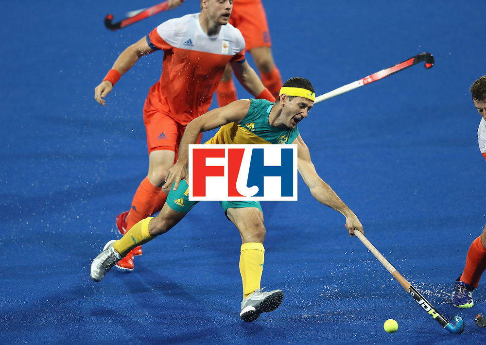 RIO DE JANEIRO, BRAZIL - AUGUST 14:  Jamie Dwyer of Australia stretches for the ball during the Men's hockey quarter final match between the Netherlands and Australia on Day 9 of the Rio 2016 Olympic Games at the Olympic Hockey Centre on August 14, 2016 in Rio de Janeiro, Brazil.  (Photo by David Rogers/Getty Images)
