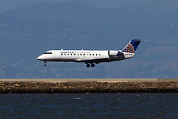 Bombardier CRJ-200ER (N919SW) operated by SkyWest Airlines for United Express landing at San Francisco International Airport (KSFO), San Francisco, California, United States of America