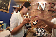 "BENXI, CHINA - JUNE 26: (CHINA OUT) <br /> <br /> Blood Bag Drink<br /> <br /> A woman makes the ""Blood Bag"", a crimson beverage offered with two flavors of blueberry and cranberry on June 26, 2014 in Benxi, Liaoning province of China. ""Blood Bag"", a crimson beverage was marked by the sign of ""Blood Type Energy Supply"" as well as the symbol of Red Cross and the beverage was for sale with the price of 30 RMB (about 4.8 USD) in China's northeast city of Benxi. <br /> ©Exclusivepix"