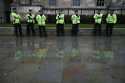 © Licensed to London News Pictures 13/04/2013.Police stand outside the National Portrait Gallery in Trafalgar Square during an anti-Thatcher demonstration, following her death last week..London, UK.Photo credit: Anna Branthwaite/LNP