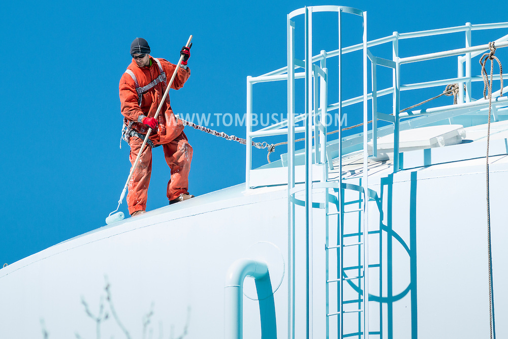 Town of Wallkill, New York - Amstar of Western New York workers paint a water tower on March 30, 2016.