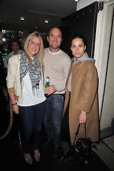 Left to right, ANNA LAUB, HUGO CHITTENDEN and OLIVIA McCALL at a screening hosted by 'The Volunteer' of a documentary film of work in Haiti, held at the Courthouse Hilton Hotel, 19-21 Great Malborough Street, London on 29th March 2011.