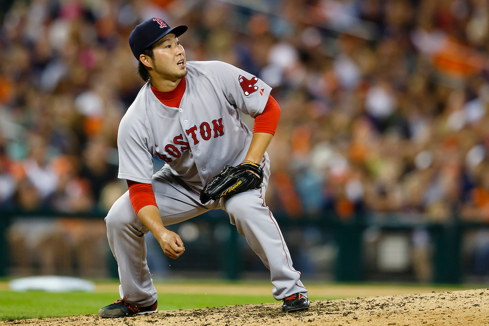 Aug 8, 2015; Detroit, MI, USA; Boston Red Sox relief pitcher Junichi Tazawa (36) watches as a ball hit by Detroit Tigers designated hitter Victor Martinez (not pictured) go over the right center field wall for a two run home run seventh inning at Comerica Park. Mandatory Credit: Rick Osentoski-USA TODAY Sports