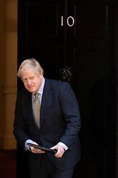 © Licensed to London News Pictures. 13/12/2019. London, UK. Prime Minister Boris Johnson returns to 10 Downing Street after adressing the nation .  Photo credit: George Cracknell Wright/LNP