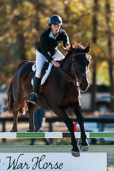 November 11, 2016 - Raeford, North Carolina, US - Nov. 12, 2016 - Raeford, North Carolina, USA - ELIZABETH McGRADY and her horse, TINY TIM, clear a jump during the 2016 War Horse Event Series Championships, Nov. 12 at Carolina Horse Park in Raeford, N.C. Founded in 2013 as the Cabin Branch Event Series, the War Horse Event Series consists of five horse trials and combined tests and attracts riders and their horses from across the eastern United States. (Credit Image: © Timothy L. Hale via ZUMA Wire)