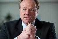 21 JAN 2010, BERLIN/GERMANY:<br /> Dirk Niebel, FDP, Bundesentwicklungshilfeminister, waehrend einem Interview, in seinem Buero, Bundesministerium fuer Entwicklungshilfe und wirtschaftliche Zusammenarbeit<br /> IMAGE: 20100121-02-034<br /> KEYWORDS: Büro