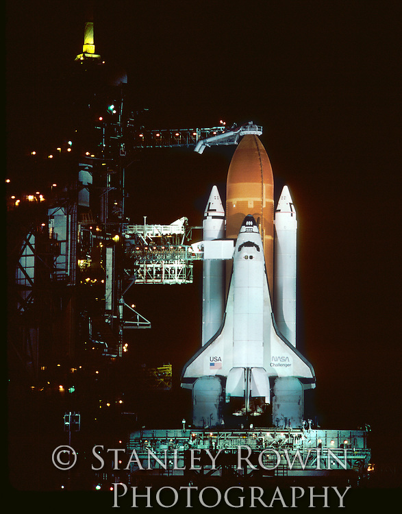 Space Shuttle Challenger on launch pad night of January 28, 1986