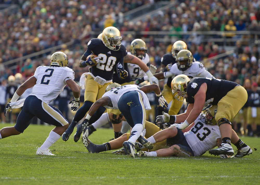 Running back Cierre Wood (20) carries in the first quarter.