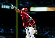 May 1 2011; Phoenix, AZ, USA; Arizona Diamondbacks batter Ryan Roberts (14) reacts after hitting a home run during the second inning against the Chicago Cubs at Chase Field. Mandatory Credit: Jennifer Stewart-US PRESSWIRE..