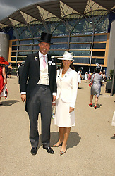 The HON.HARRY & MRS HERBERT at the first day of the Royal Ascot racing festival 2006 at Ascot Racecourse, Berkshire on 20th June 2006.<br />