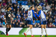 Kayleigh Green (Brighton & Hove) celebrates her goal with Kirsty Barton (Brighton & Hove) with Adrienne Jordan (Birmingham) in the background during the FA Women's Super League match between Brighton and Hove Albion Women and Birmingham City Women at the American Express Community Stadium, Brighton and Hove, England on 17 November 2019.