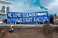 """We Love S.S. Lazio 1900 - We Fight Racism"".<br /> A group of Lazio fans staged a flash mob at the Colosseum on Thursday to show that not all supporters of Rome's oldest soccer club are racist before the second leg of their last-16 Europa League tie against Sparta Prague. Lazio have been punished for racism by their fans on several occasions in the past and they risk fresh sanctions after visiting supporters subjected Sparta's full back Costa, who is black, to jeers when he touched the ball in the first leg in Prague last week. Rome, Italy 17th March 2016"