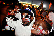Locals, England and USA fans gather before the 2010 FIFA World Cup South Africa Group C match between England and USA at the Royal Bafokeng Stadium on June 12, 2010 in Rustenburg, South Africa.