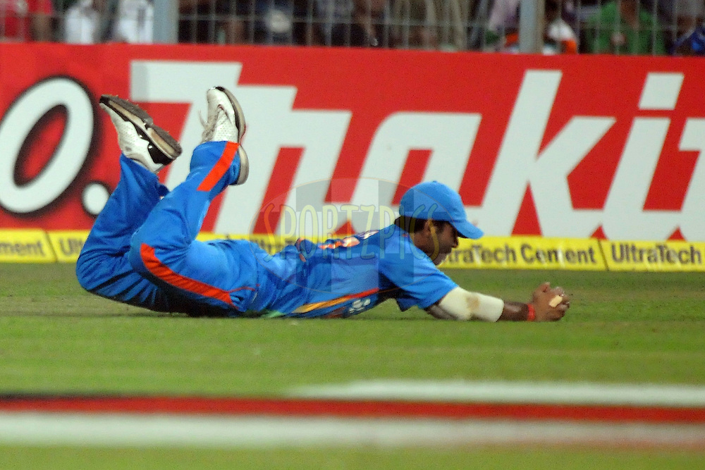 Ajinkya Rahane of India takes a catch during the T20 International match between India and England held at the Eden Gardens Stadium, Kolkata on the 29th October 2011..Photo by Pal Pillai/BCCI/SPORTZPICS